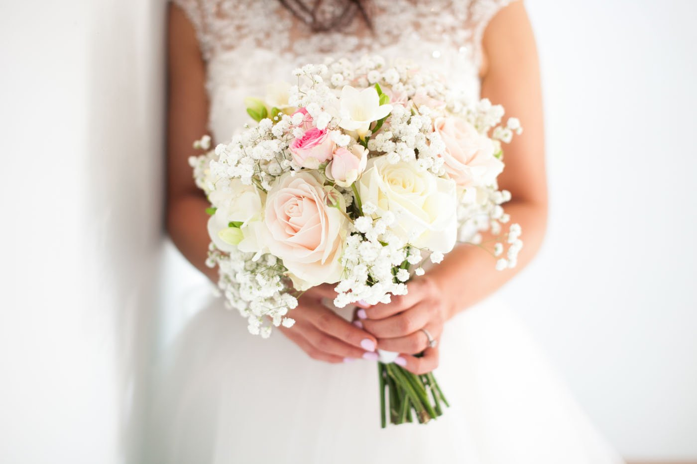 Close up photo of a brides pink and white bouquet at St Tewdrics
