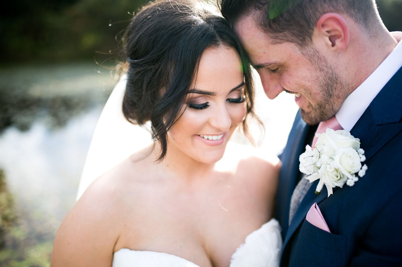 A bride and groom lower their foreheads together at Oldwalls