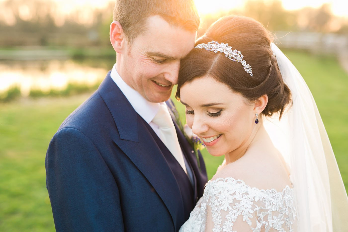 At Stone House Court, a bride and groom hug at sunset
